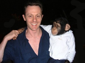 Self-shooting producer-director John Gubba with Mike the chimpanzee.