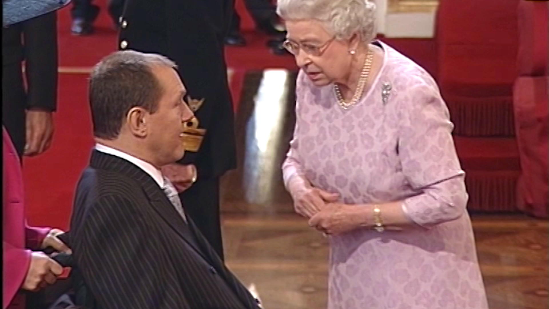 Phil Downs receives MBE from the Queen in 2004